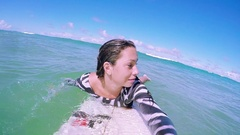 POV Of A Beautiful Surfboarder Paddling To Catch A Wave Surfing In Slow Motion Stock Footage