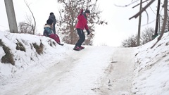 Boy snowboarding in the snow with winter holidays Stock Footage