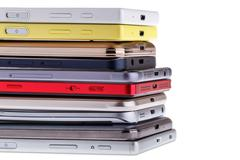 Pile of mobile phone. Heap of the different smartphones isolated on white b.. Stock Photos