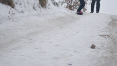 Boy snowboarding in the snow with a winter holidays Stock Footage