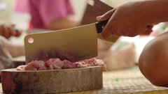 Pork mincing on a wooden chopping block with a cleaver Stock Footage