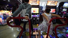Kids play play Pump It UP in MBK mall, Bangkok Stock Footage