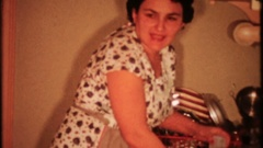 Mother & daughter play around in the kitchen, 3900 vintage film home movie Arkistovideo