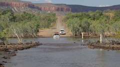 4x4 Vehicle crossing Pentecost River on Gibb River Road Stock Footage