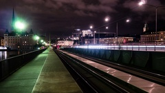 Time Lapse of railway tracks next to pedestrian walkway in Stockholm city Stock Footage