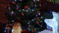 Santa Claus toy under the Christmas tree Stock Footage