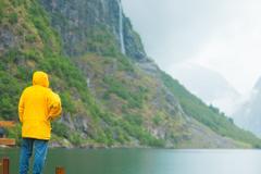 Tourist loking at mountains and fjord Norway, Scandinavia. Stock Photos
