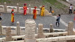 Chinese people in traditional costumes in Forbidden City in Beijing, China Stock Footage
