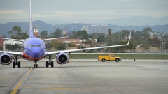 Southwest Airlines Boeing jet airplane arriving taxiing at LAX airport Stock Footage