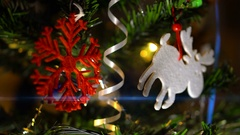 New year toys and garlands lights on the Christmas tree Stock Footage