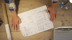 4K Unrecognizable team of architects in a meeting looking at floor plan Stock Footage