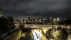 Time Lapse of railway tracks and urban road at night Stock Footage