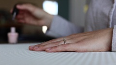 Woman paints neutral nails Stock Footage