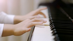 Child playing piano. Stock Footage