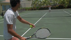 A young couple playing tennis together, slow motion. Stock Footage