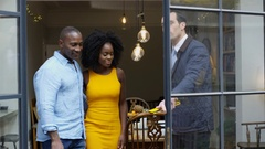 4K Happy couple with real estate agent, looking at home to buy or rent Stock Footage