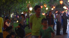People walk in the park on Tet holiday, Vung Tau city, Vietnam Stock Footage