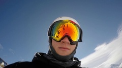 POV of a young man skier taking a selfie while on a snow covered mountain top, s Stock Footage