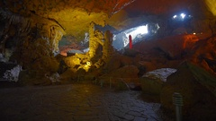 Tourists in Thien Cung Cave (Heavenly Palace Cave), near Halong Bay, Vietnam Stock Footage