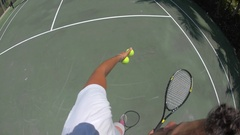 POV of a young woman playing tennis against her boyfriend, slow motion. Stock Footage