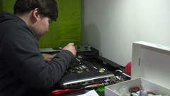 A Computer Genius Boy Fixing the problem in notebook Stock Footage