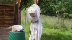 Protective clothing of a beekeeper Stock Footage