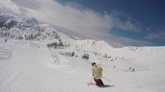 A young man freestyle skier crashes into snow while skiing off a jump in a terra Stock Footage