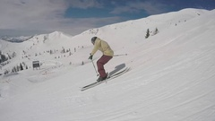 A young man freestyle skier skiing in a terrain park on a snow covered mountain, Stock Footage