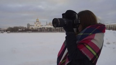 The girl photographing in the winter on the street Stock Footage