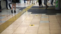 Old metro station tile floor with lot of commuters walking on it Stock Footage
