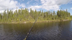 Chesty fishing cast the rod 4k Stock Footage