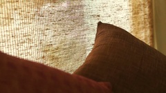 Close up Brown sofa pillow and and beige curtain, Interior oriental style Stock Footage