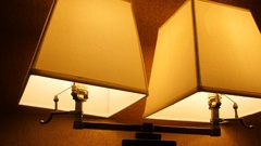 A dolly shot of lamps turned on in a bedroom at night Stock Footage