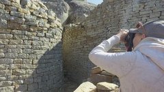 Acient ruins being photographed 4k Stock Footage