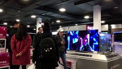 Motion of people looking new tv inside Best buy store on boxing day sale Stock Footage