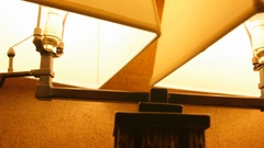 Dolly shot of lamps turned on in a room at night Stock Footage