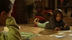 Children playing monopoly Stock Footage