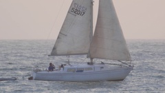 Sail boat sailing on the Pacific ocean coastline. Stock Footage