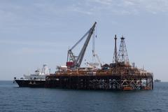 Oil platform and tanker ship Stock Photos