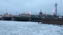 Winter view of the ice-covered Neva river, Palace Bridge, Admiralty and Saint Stock Footage