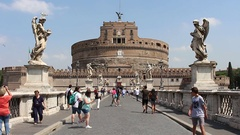 People walk on St. Angelo Bridge (Ponte Sant'Angelo) in Rome. Stock Footage