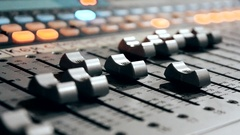 Hand moving a cursor on a mixer board Stock Footage