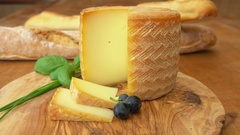 Cheese head Etorki with a piece cut out Stock Footage