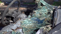 Burnt steering wheel and shards of windscreen glass Stock Footage