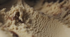 Scooping vanilla tiramisu ice cream heavily frozen Stock Footage