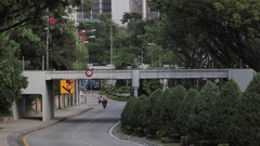 A light rail transit crossing over the road Stock Footage