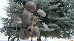 Copper twirly yard ornament spins rapidly in brisk wind Stock Footage