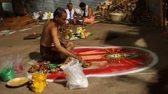 Brahman drawing a rangoli depicting divinity of Narasimha Stock Footage