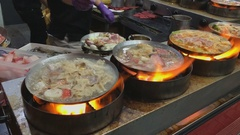 Taiwanese traditional hotpot on fire Stock Footage