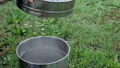 Slow motion sifting ashes Stock Footage